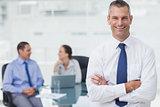 Smiling businessman posing crossing arms