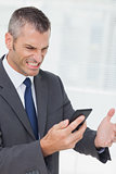 Businessman getting angry after a phone call