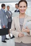 Cheerful businesswoman holding files posing
