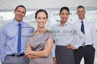Cheerful work team posing together