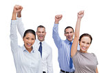 Cheerful work team posing with hands up