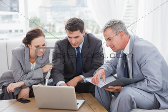 Business people working together on their laptop
