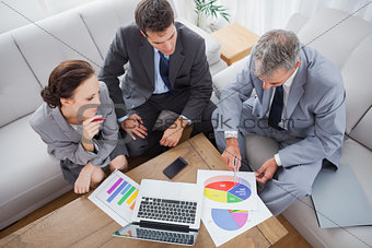 Business people analyzing diagrams together