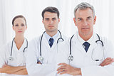 Serious doctors posing together
