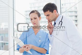 Focused surgeon and doctor working together