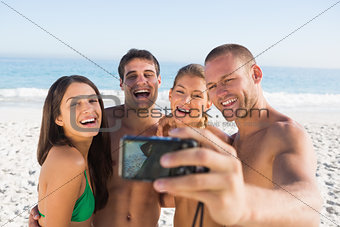 Cheerful friends taking pictures of themselves