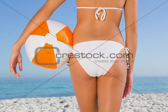 Close up of perfect young womans buttocks with beach ball