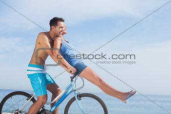 Man giving girlfriend a lift on his crossbar