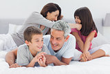 Family together on bed