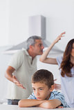 Couple having dispute in front of their upset son