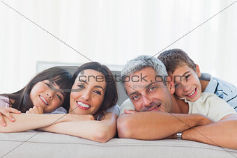 Beautiful family in sitting room smiling at camera