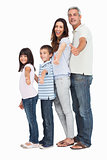 Portrait of a cute family in single file doing thumbs up at camera