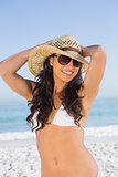 Happy attractive brunette with straw hat and sunglasses