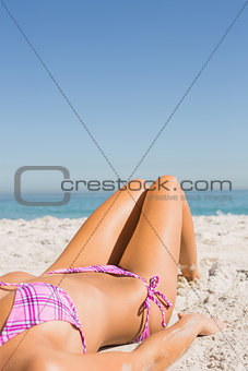 Close up of young womans body while sunbathing