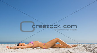 Slim young woman posing while sun bathing