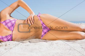 Body of tanned young woman sunbathing
