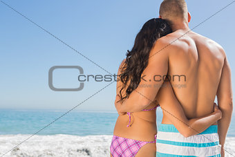 Relaxed cute couple hugging one another