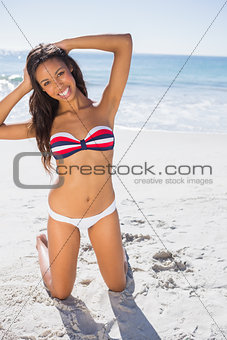 Happy young sexy woman taking sun
