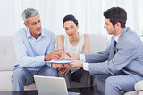 Salesman giving contract to client and his wife