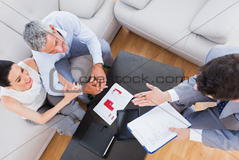 Salesman making his pitch to couple