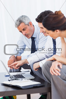 Business people working with their laptop on sofa