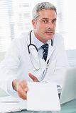 Doctor giving prescription to camera