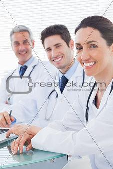 Smiling doctors looking at camera