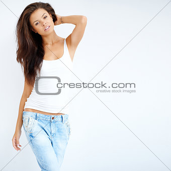 Adorable young girl posing in white shirt