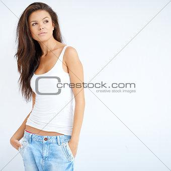 Beautiful brunette girl posing over white