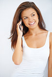 Happy young brunette talking her mobile phone