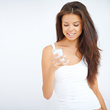 Young woman reading a message on her phone