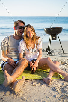 Happy couple having barbecue together