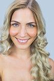 Smiling beautiful natural blonde posing