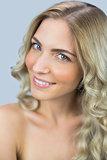 Smiling natural blonde posing while looking at camera