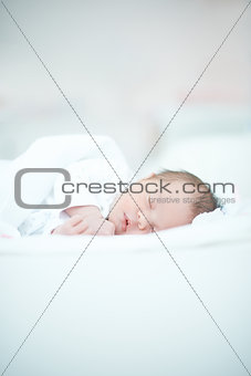 Newborn Baby Laying on White Bed