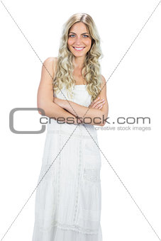 Smiling attractive model in white dress posing