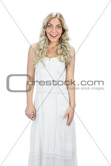 Surprised attractive model in white dress posing