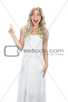 Astonished attractive model in white dress posing