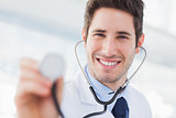 Smiling doctor with his stethoscope looking at camera