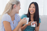Young friends catching up over cups of coffee