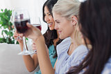 Happy friends having red wine together