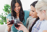 Cheerful friends having red wine together
