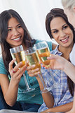Cheerful friends enjoying white wine together
