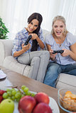 Laughing friends playing video games