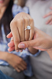 Close up of engagement ring on womans hand