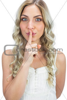 Attractive blonde hiding secret