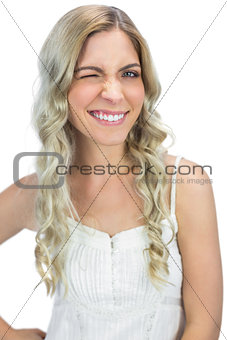 Attractive blond model winking to camera