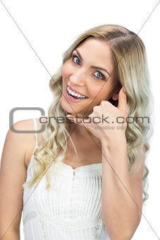 Attractive blue eyed model making call gesture
