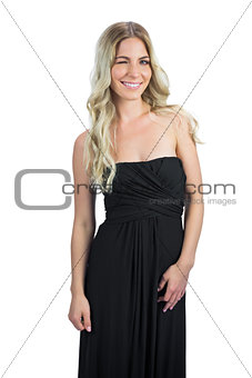 Attractive blonde with black cocktail dresswinking at camera
