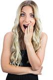 Surprised gorgeous blonde in black dress posing